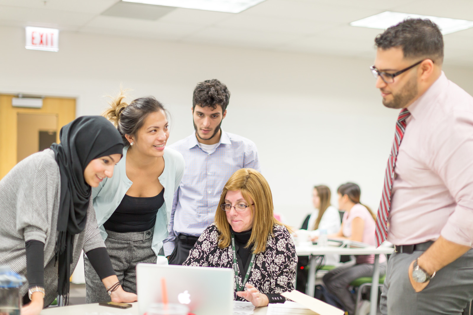 A Roosevelt professor working with a group of students