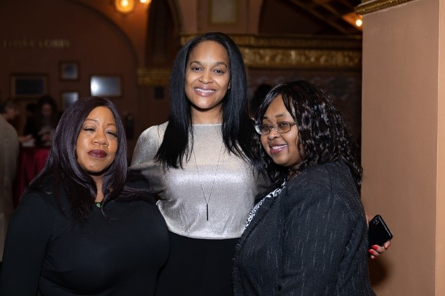 Three friends of Roosevelt University at an alumni luncheon