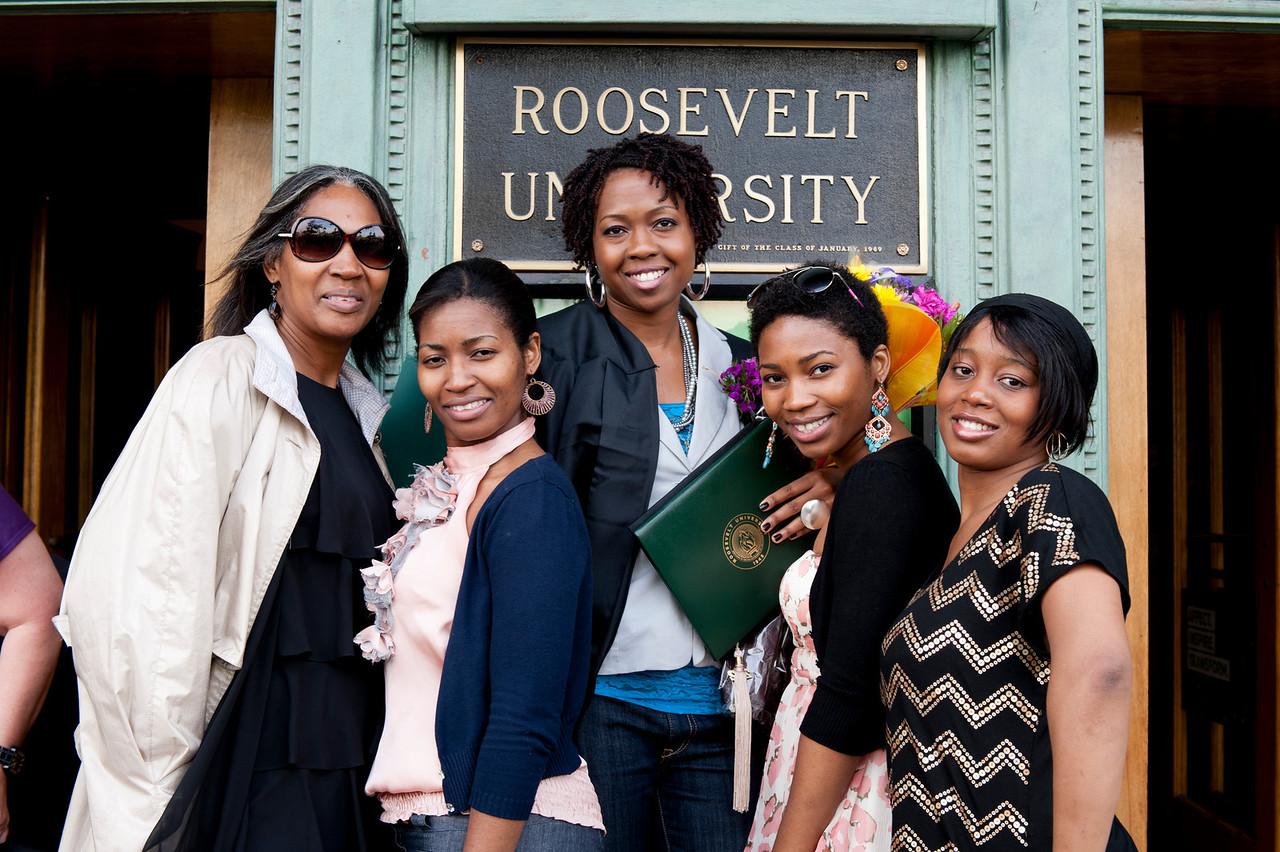 Five Black Roosevelt alumni, standing in front of the Michigan Avenue